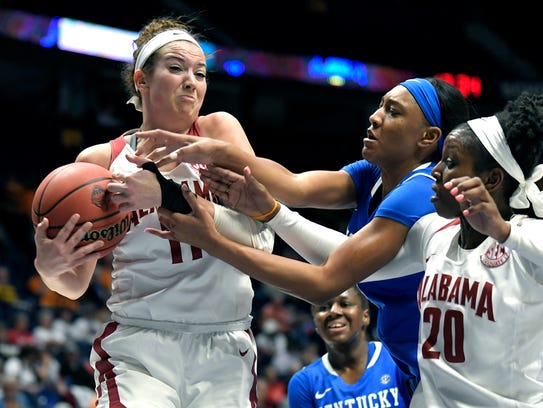 Alabama's Hannah Cook (#11) fights for a rebound against