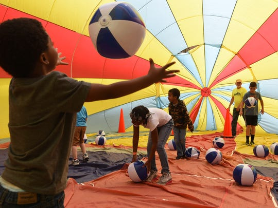 Jalen Bannister, 4, throws around a beach ball inside of a semi-inflated hot-air balloon at the Hudson Valley KidVenture in the City of Poughkeepsie.