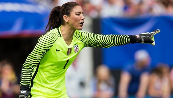 American goalkeeper Hope Solo directs her defense in