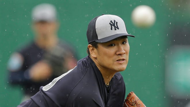 New York Yankees starting pitcher Masahiro Tanaka warms up during the first inning of a spring training baseball game against the Philadelphia Phillies Tuesday, March 29, 2016, in Clearwater, Fla.
