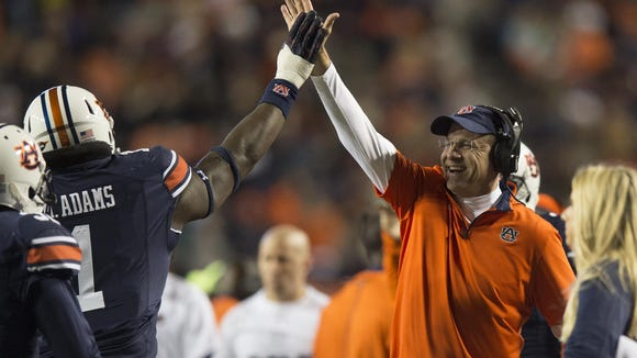 Auburn defensive tackle Montravius Adams (1) high fives Auburn head coach Gus Malzahn after intercepting a pass during the NCAA football game between Auburn vs. Alabama A&M Saturday, Nov. 19, 2016, in Auburn, Ala.