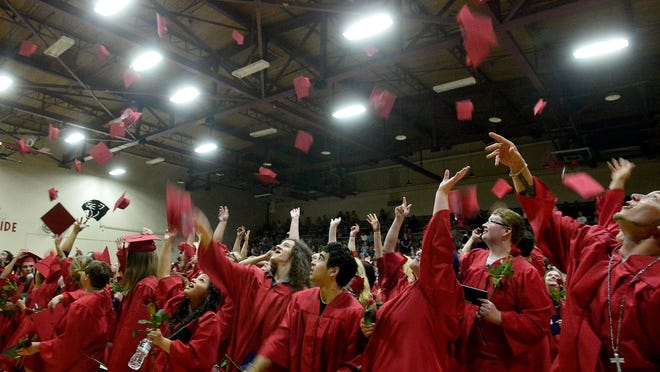 The Paris Gibson Education Center Class of 2015 toss their caps in the air at the conclusion of Tuesday evening's ceremony.