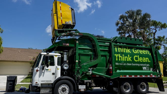 Ludes Joseph collects trash for Waste Management using a semi-automated claw and bin system in Wellington on July 26, 2018.