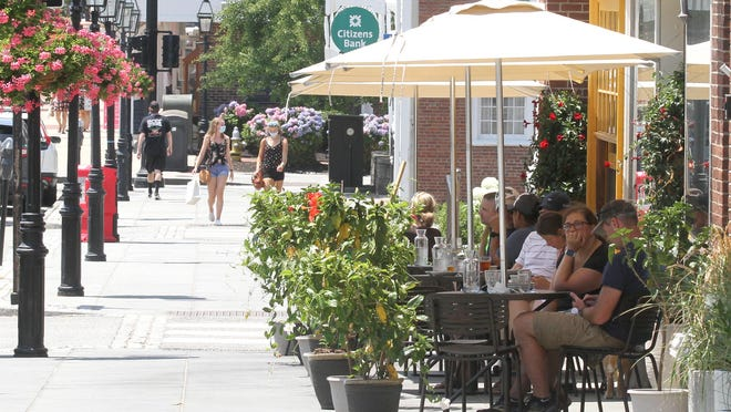 Diners sit outside Bar 'Cino in Washington Square Thursday afternoon. While restaurants are seeing some customers retur,n tax collection figures from the state show a steep decline in collections in April, the first full month of coronavirus-related closures.