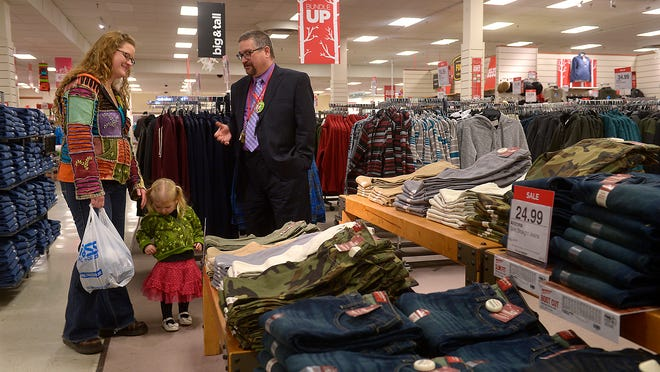 JCPenney store manager Edward Larson greets customer Katy Dalton who was on a shopping trip with her daughter Kinleigh, age 2. Dalton, a former retail clerk, said she understands the importance of attentive customer service in combatting shoplifting.