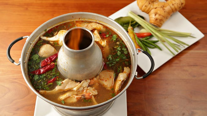 The tom yum goong, spicy/sour lemongrass-scented soup swimming with prawns and oyster mushrooms. from Soi 4. As seen in Scottsdale on 7/1/2014 Credit: John Samora/The Arizona Republic.