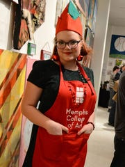 Elf volunteer and MCA student Kaylee Hamann served at a previous Holiday Bazaar. Elves are a festive addition to the event and help partygoers retrieve work from the walls that they would like to purchase.
