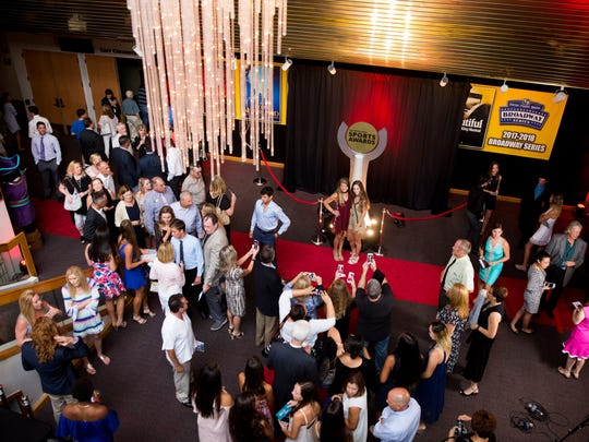 Collier and Lee County high school student-athletes take advantage of the red carpet backdrop to take photos with friends prior to the start of the Southwest Florida Sports Awards at the Barbara B. Mann Performing Arts Center Wednesday, May 24, 2017 in Fort Myers, Fla.