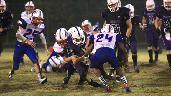West Henderson football players make a tackle during a game earlier this season against North Henderson.