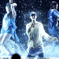 The Biebs is literally making it rain.
