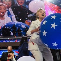 Hillary Clinton throws a balloon into the crowd at the close of the Democratic National Convention.