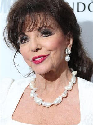 """In this file photo, Joan Collins arrives for the Glamour Women of the Year Awards at Berkeley Square Gardens London. Collins the diva of """"Dynasty"""" is now a dame. Joan Collins, who played scheming, shoulder pad-wearing Alexis Carrington in the hit 1980s TV show, was made the female equivalent of a knight in Queen Elizabeth annual New Year's honors list."""