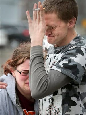 Katherine Ide and her brother Jason Thomas mourn the loss of their cousin Noah Terry Thomas, age 5, who was found dead in a septic tank in Pulaski County Thursday March 26 2015.