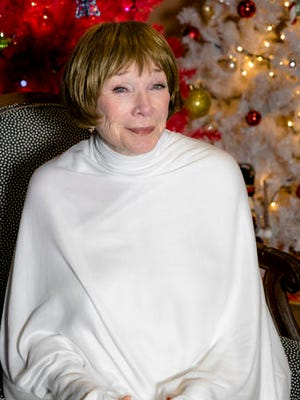 "In this image released by the Hallmark Channel, actress Shirley MacLaine plays an angel in ""A Heavenly Christmas,"" a Hallmark Hall of Fame TV movie airing 8 p.m. EST Saturday on the Hallmark Channel."