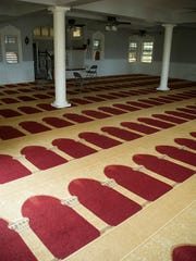 This Thursday, March 9, 2107 photo shows the prayer room of the Muslim Association of Hawaii building in Manoa Valley in Honolulu. The mosque has been serving Hawaii for nearly 50 years, according to the group. The column designs on the carpet are designed to face Mecca.