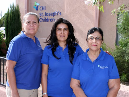 Staff at CHI St. Joseph's Children in Deming are working through the COVID-19 pandemic and providing Tele-health Home Visits in Luna County for expectant mothers and families with infants. The Deming and Luna County staff are, from left, Cruz Granado, New Mexico Program Director Mari Garcia and Dolores Valdez. The Deming office is located at 201 E. Pine St.