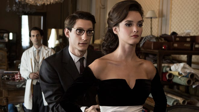 Pierre Niney (left) and Charlotte Le Bon in a scene from the film 'Yves Saint Laurent.'