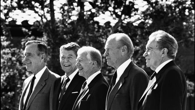 George H.W. Bush, Ronald Reagan, Jimmy Carter, Gerald Ford and Richard Nixon.