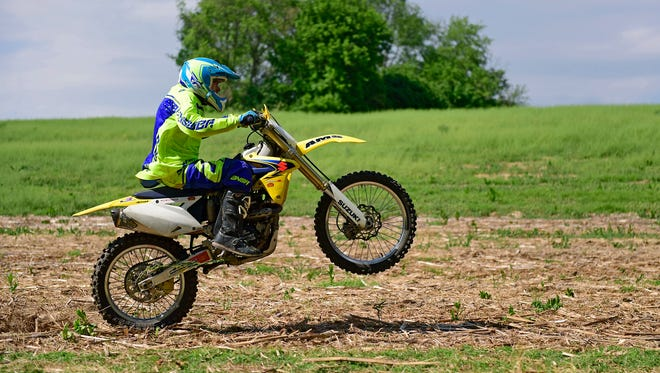 Mark Frahn on May 11, 2018 rides a dirt bike for the first time since his June 11, 2017 accident in the backyard of his Codorus Township home. Frahn fractured his L1 vertebrae after crashing his dirt bike. Doctors told him he wouldn't be able to walk again.
