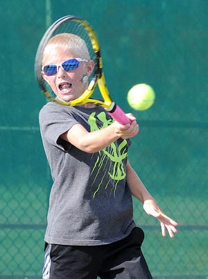 Pete Bombadier volleys a return against Ethan Remy in Tuesday's boys 10-and-under final of the 82nd News Journal/Richland Bank Tennis Tournament at Lakewood Racquet Club. Pete won a third-set tiebreaker for his fourth title in that division.