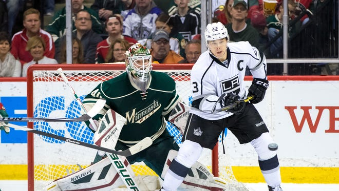 Los Angeles Kings forward Dustin Brown (23) looks to tip the puck in the second period against the Minnesota Wild goalie Devan Dubnyk (40) at Xcel Energy Center.