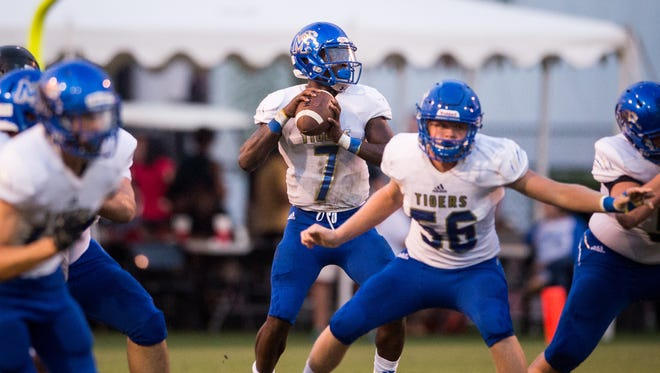 Martin County quarterback George Johnson III gets plenty of time to pass in the first quarter against South Fork during the Martin Bowl high school football game Thursday, Sept. 28, 2017, at South Fork High School in Tropical Farms.