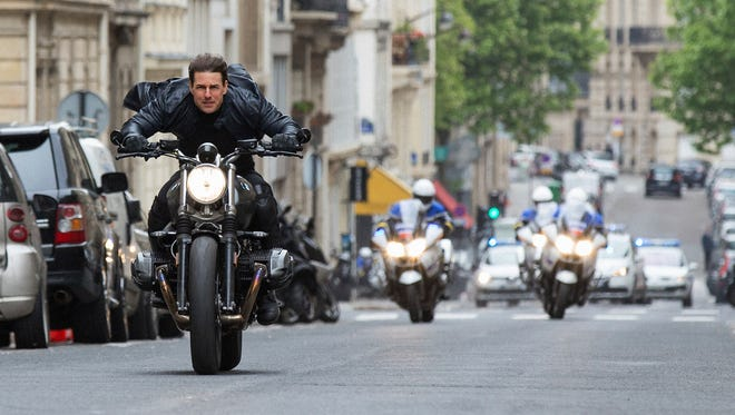 """Tom Cruise races for cover in """"Mission: Impossible - Fallout."""""""