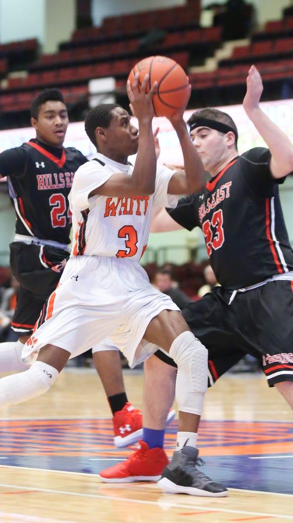 White Plains' Mekhi Woodbury (3) drives the basket
