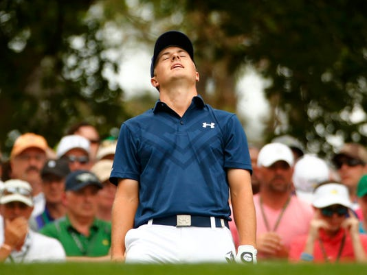 Jordan Spieth of the U.S. reacts after hitting his tee shot off the fourth tee during final round play of the Masters golf tournament at the Augusta National Golf Course in Augusta