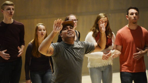 DeJour Hood takes a solo while performing with members of student a cappella group YCP Rhapsody at York College.