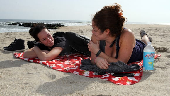 After working an overnight shift at CentraState Medical Center, Shannon Merrigan (left), Belmar, and Nicole Cannon, Sayreville, enjoy the sunshine and warm temperatures on the Belmar beach Wednesday, February 8, 2017.