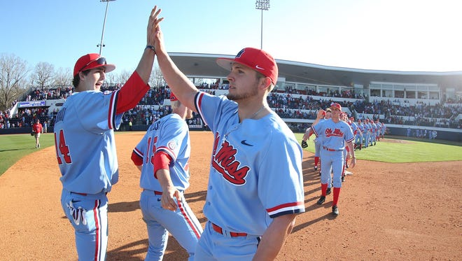 Ole Miss closer Dallas Woolfolk (right) has recorded 10 saves this season.