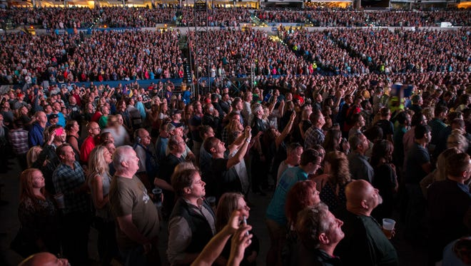 A nearly full house watches as U2 performs songs off their 1987 album Joshua Tree, at Lucas Oil Stadium, Indianapolis, Sunday, September 10, 2017.