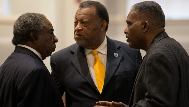 Montgomery School Board chairman Robert Porterfield, right, speaks with Montgomery County Commission chairman Elton Dean and Judge Charles Price during a press conference on Thursday, Jan. 11, 2018, in Montgomery, Ala. The press conference was held to discuss on the state of the Montgomery Public School system.