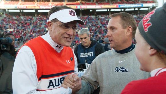 Auburn coach Gus Malzahn shakes Mississippi coach Hugh