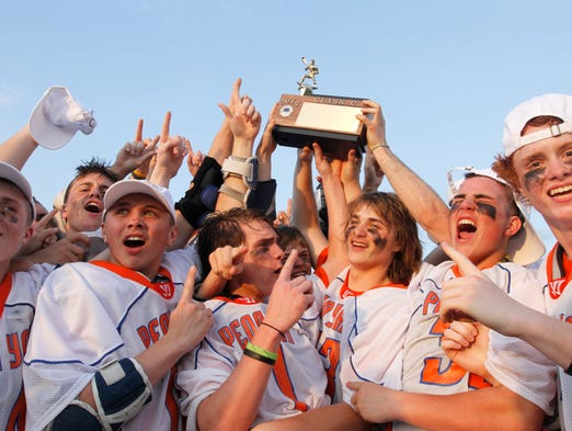 Penn Yan players celebrate with the Class C trophy.