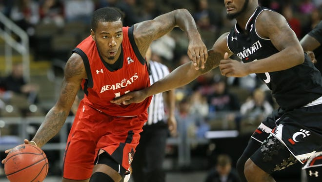 Cincinnati Bearcats senior forward Gary Clark (left) is two points away from 1,000 for his career. UC opens the season Friday (noon) against Savannah State at NKU.