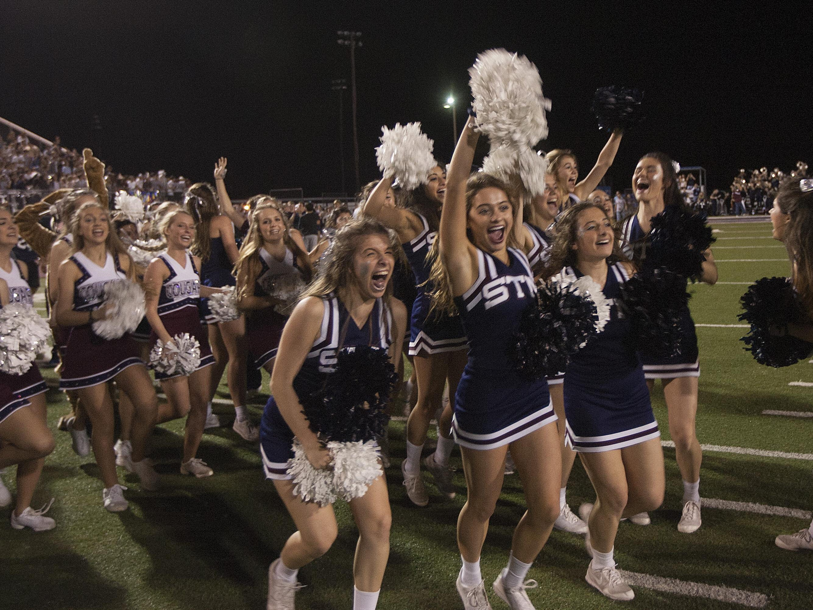 St. Thomas More cheerleaders celebrate the final moments of the Cougars' state semifinal victory over Teurlings Catholic to advance to the Division II state championship game at 5 p.m. Friday in the Mercedes-Benz Superdome.