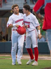 Freshman shortstop Hayden Cantrelle, right, congratulates Zach LaFleur, left, after the senior outfielder scored a run in UL's win over UNO earlier this season.