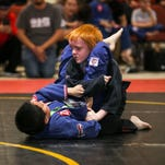 Competitors Lyzandar Jimenez, left, and Gabriel Sulentic, each 8 years old, battle it out during the 23rd annual Grapplefest at the Las Cruces Convention Center on Saturday. According to organizers Grapplefest is the largest grappling and Brazilian Jiu-Jitsu event in the Southwest with at least 400 people ages 5 to 55 participating.