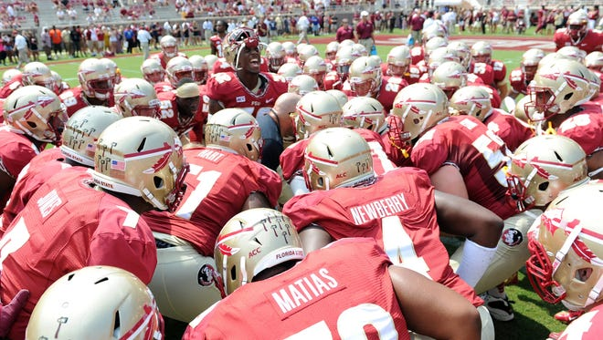 Florida State Seminoles players huddle and get ready before the start of the game against the Nevada Wolf Pack at Doak Campbell Stadium. Mandatory Credit: Melina Vastola-USA TODAY Sports ORG XMIT: USATSI-135226 ORIG FILE ID:  20130914_jla_av1_328.jpg