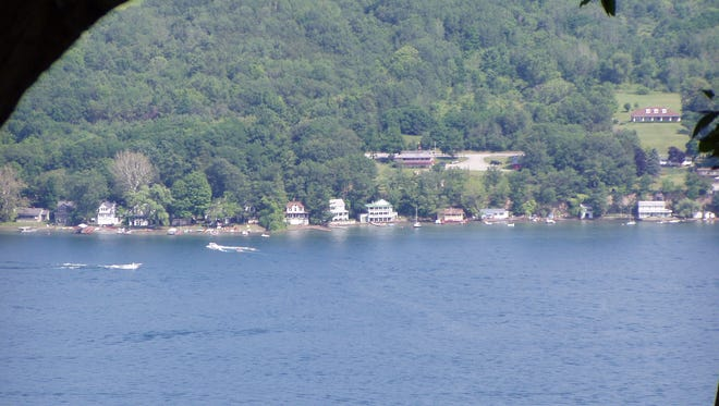 Group of cottages on east side of Keuka Lake. Photo by Amy Sutryn, taken from one mile across the water, in the Garrett Chapel, in Bluff Point