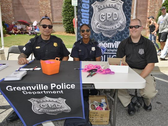 Greenville police officers pose for a photo during First Responders Day at a 2016 Greenville Drive game.