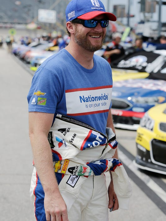 Dale Earnhardt Jr. smiles on pit road before qualifying for a NASCAR Cup auto race at Darlington Raceway, Saturday, Sept. 2, 2017, in Darlington, S.C. (AP Photo/Terry Renna)