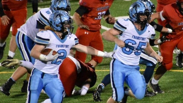 Frankfort's Peyton Clark (2) follows the lead of blocker Jacob Logsdon (65) as he heads downfield against Washington.