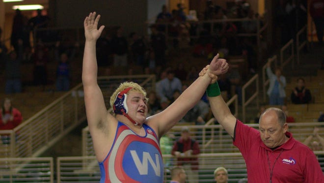 Wakulla senior wrestler Jacob Marin reacts after winning an FHSAA Class 1A state title in his heavyweight classification on Saturday night in Kissimmee.