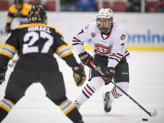 St. Cloud State's Nick Poehling skates with the puck
