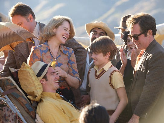 Andrew Garfield, center, plays the real-life Robin Cavendish in 'Breathe.' With the support of his wife, Diana (Claire Foy), and son, Jonathan (Harry Marcus), Robin lived for more than 30 years using a ventilator after becoming paralyzed from the neck down as a result of polio.