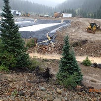 Officials defend action on treatment pond spill
