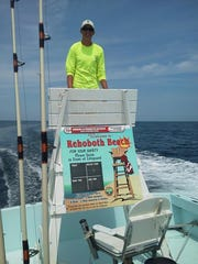 Mate Luke Sampson on a recovered lifeguard stand aboard the Fish Finder. The stand was found five miles out in the ocean.